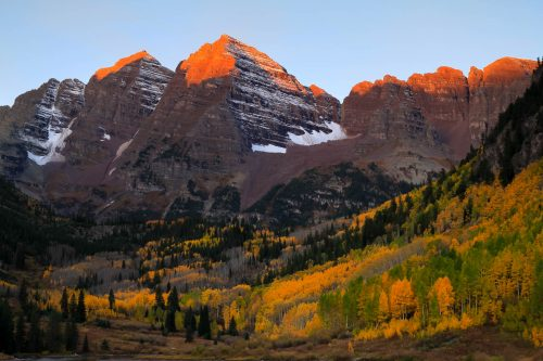 First sun rays on Maroon Peak